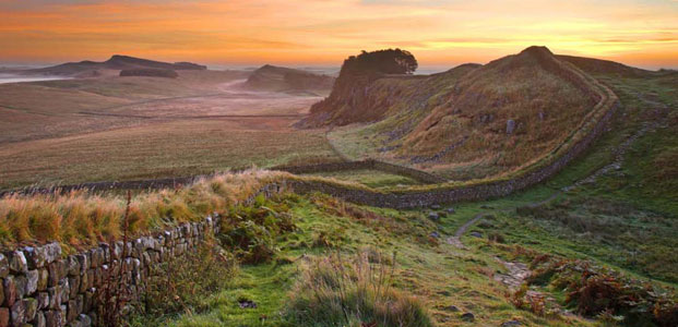 A section of the historic Hadrian's Wall at dusk.