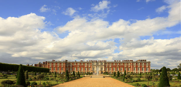 A cloudy blue sky over Hampton Court Palace - a historic home for royals