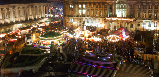 lights illuminate festively decorate stalls and a merry-go-round in Birmingham and Christmas